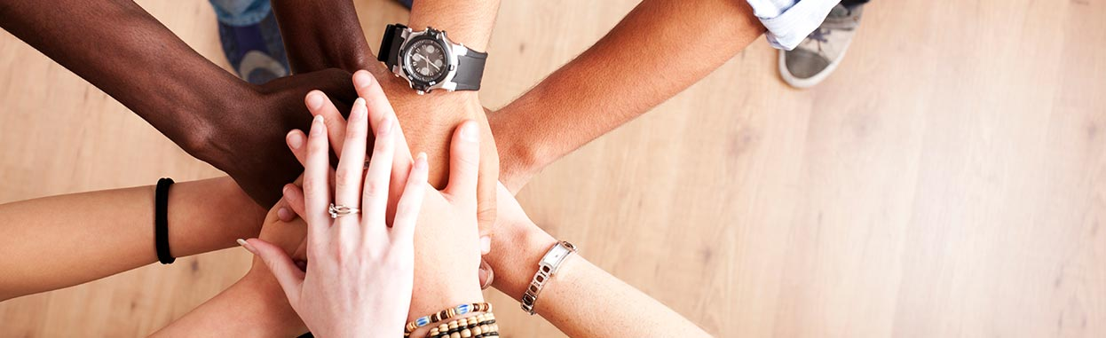 Photo of group with hands together