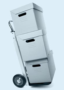 Backfile Scanning Benefits photo: hand truck loaded with 3 boxes